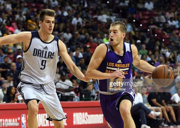 Matt Thomas of the Los Angeles Lakers drives against Nicolas Brussino of the Dallas Mavericks during a semifinal game of the 2017 Summer League at...