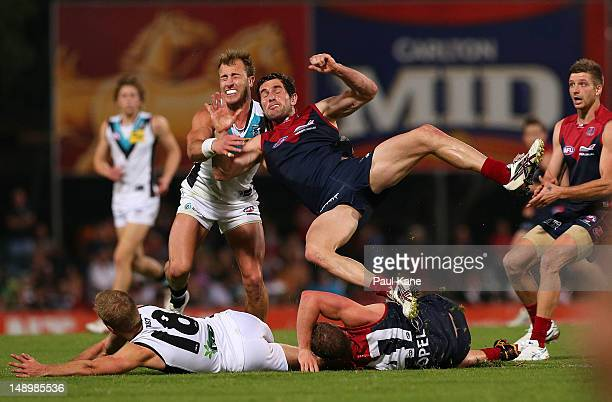 Matt Thomas of the Power tackles Joel MacDonald of the Demons during the round 17 AFL match between the Melbourne Demons and Port Adelaide Power at...