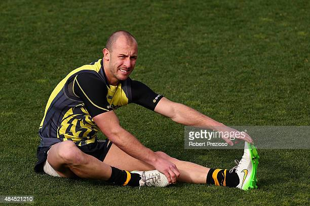 Matt Thomas stretches during a Richmond Tigers AFL training session at the ME Centre on August 20 2015 in Melbourne Australia