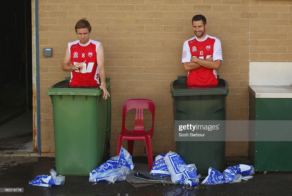 Matt Thompson and Josip Tadic of the Heart look on as they stand in an ice bath during a Melbourne Heart A-League training session at La Trobe University Sports Fields on February 21, 2013 in Melbourne, Australia.