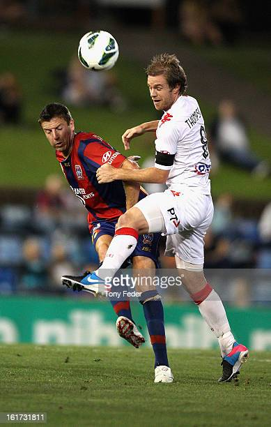 Matt Thompson of Melbourne Heart contests the ball with Michael Bridges of Newcastle Jets during the round 21 ALeague match between the Newcastle...