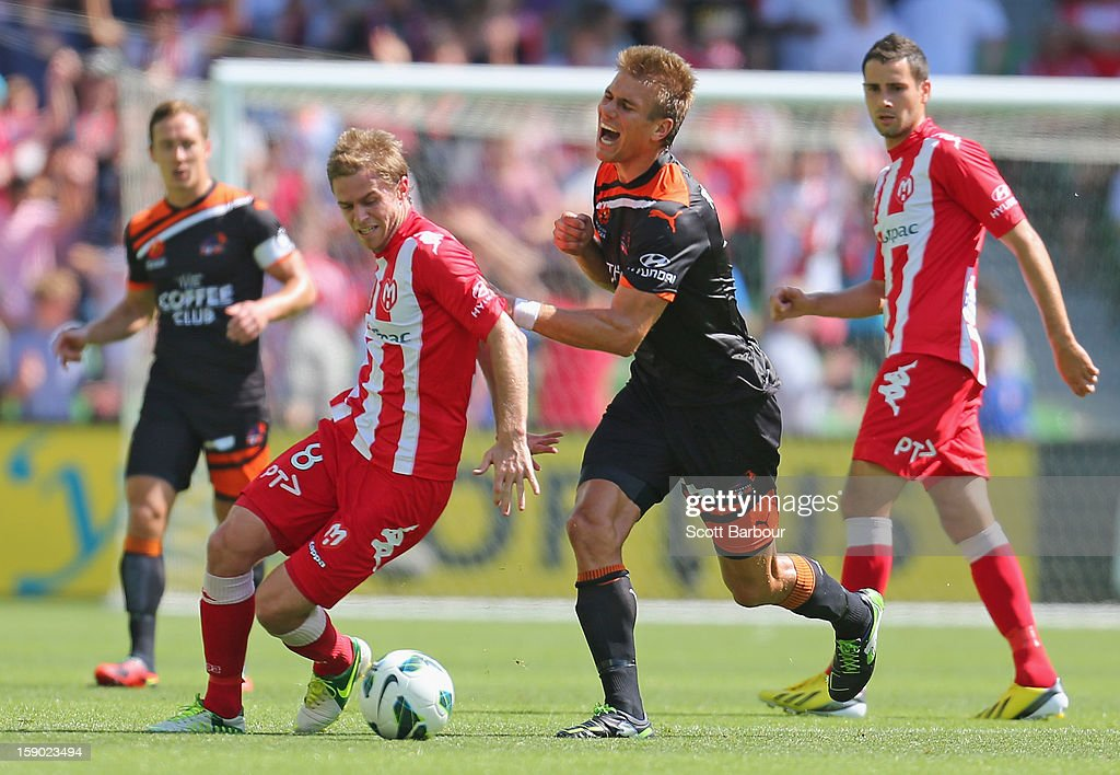 Matt Thompson of the Heart and Erik Paartalu of the Roar compete for the ball during the round 15 A-League match between the Melbourne Heart and the Brisbane Roar at AAMI Park on January 6, 2013 in Melbourne, Australia.