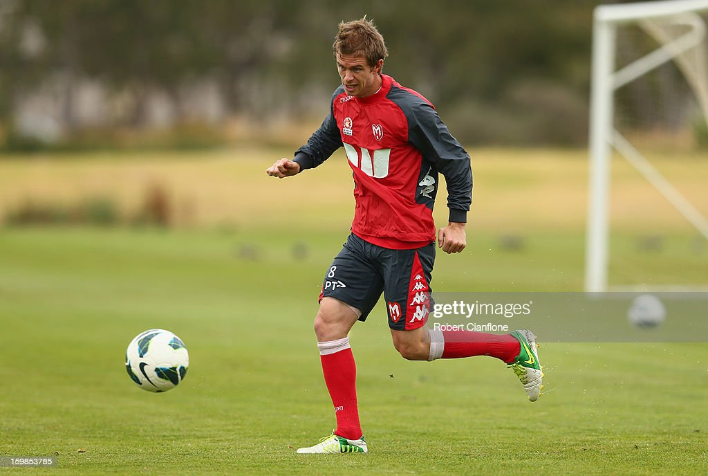 Matt Thompson of the Heart runs with the ball during a Melbourne Heart A-League training session at La Trobe University Sports Fields on January 22, 2013 in Melbourne, Australia.