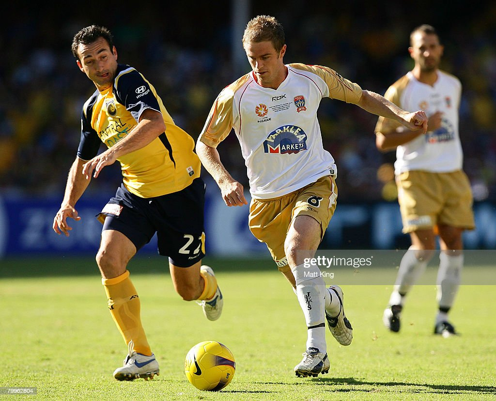 Matt Thompson of the Jets controls the ball in front of Sasho Petrovski of the Mariners during the A-League Grand Final match between the Central Coast Mariners and the Newcastle Jets at the Sydney Football Stadium on February 24, 2008 in Sydney, Australia.