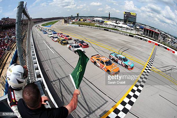 Matt Tifft driver of the NOS Energy Drink Toyota and Daniel Suarez driver of the ARRIS Toyota lead the field to the green flag to start the NASCAR...
