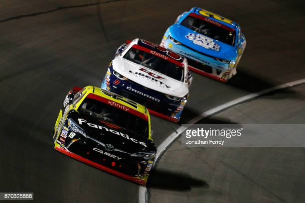 Matt Tifft driver of the Surface Sunscreen/Fanatics Toyota leads William Byron driver of the Liberty University Chevrolet and Daniel Hemric driver of...