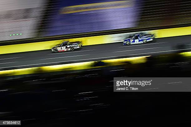 Matt Tifft driver of the ToyotaCare Toyota leads Tyler Reddick driver of the BBR Music Group Ford during the NASCAR Camping World Truck Series North...
