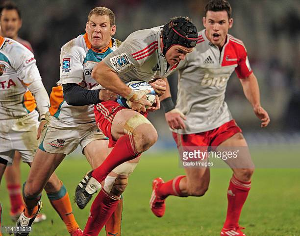 Matt Todd of the Crusaders and Barry Geel of the Toyota Cheetahs during the Super Rugby Rd 13 match betweenToyota Cheetahs and Crusaders at Vodacom...