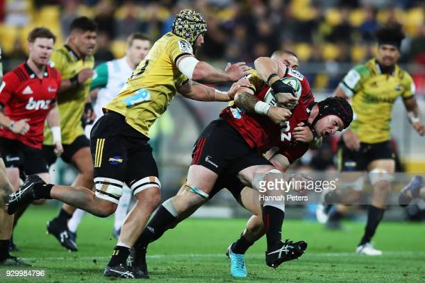 Matt Todd of the Crusaders charges forward during the round four Super Rugby match between the Hurricanes and the Crusaders at Westpac Stadium on...