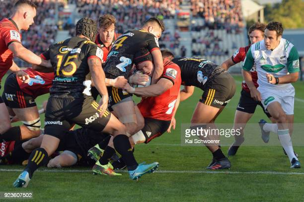 Matt Todd of the Crusaders dives over to score a try during the round two Super Rugby match between the Crusaders and the Chiefs at AMI Stadium on...