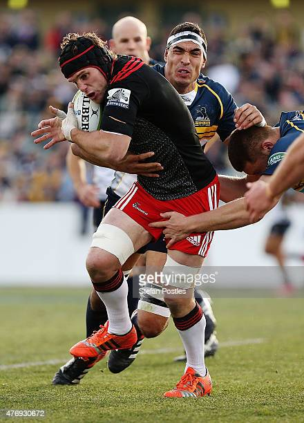 Matt Todd of the Crusaders is tackled during the round 18 Super Rugby match between the Brumbies and the Crusaders at GIO Stadium on June 13 2015 in...