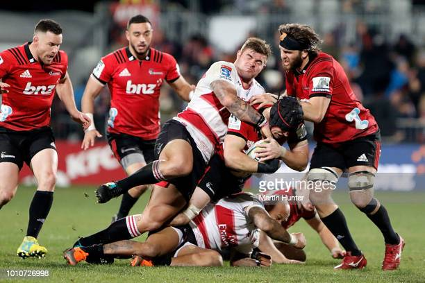 Matt Todd of the Crusaders is tackled during the Super Rugby Final match between the Crusaders and the Lions at AMI Stadium on August 4 2018 in...