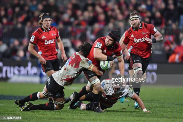 Matt Todd of the Crusaders offloads the ball during the Super Rugby Final match between the Crusaders and the Lions at AMI Stadium on August 4 2018...