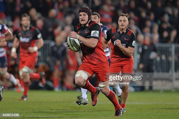 Matt Todd of the Crusaders runs through to score a try during the round 16 Super Rugby match between the Crusaders and the Rebels at AMI Stadium on...