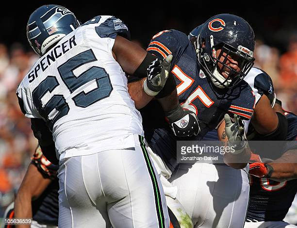 Matt Toeaina of the Chicago Bears rushes against Chris Spencer of the Seattle Seahawks at Soldier Field on October 17 2010 in Chicago Illinois The...