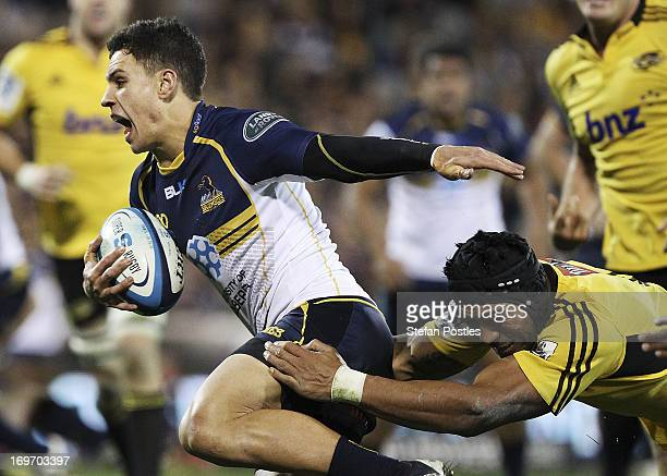 Matt Toomane of the Brumbies is tackled during the round 16 Super Rugby match between the Brumbies and the Hurricanes at Canberra Stadium on May 31...