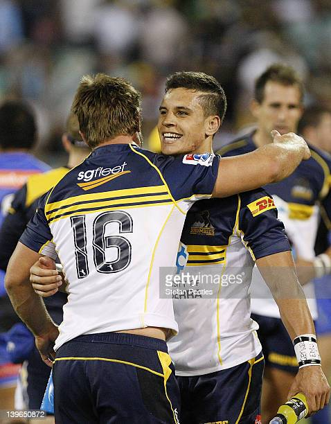 Matt Toomua and Anthony Hegarty of the Brumbies celebrate after winning the round one Super Rugby match between the Brumbies and Force at Canberra...