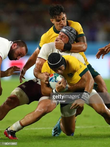 Matt Toomua grabs Beka Gorgadze o Georgia who in turn tackles Christian Lealiifano of Australia during the Rugby World Cup 2019 Group D game between...