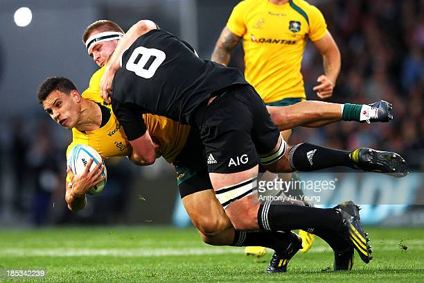 Matt Toomua of Australia is tackled by Kieran Read and Sam Cane of New Zealand during The Rugby Championship match between the New Zealand All Blacks...