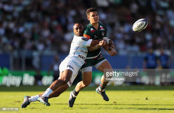 Matt Toomua of Leicester off loads the ball as Joe Rokococko tackles during the European Rugby Champions Cup match between Racing 92 and Leicester...