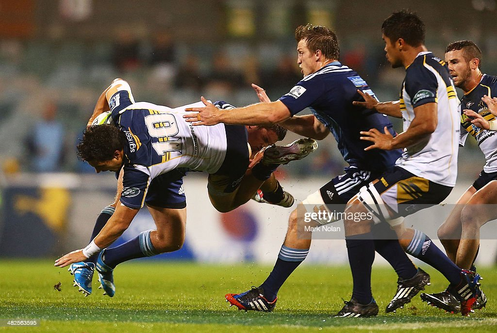 Matt Toomua of the Brumbies is tackled during the round eight Super Rugby match between the Brumbies and the Bulls at Canberra Stadium on April 4, 2014 in Canberra, Australia.