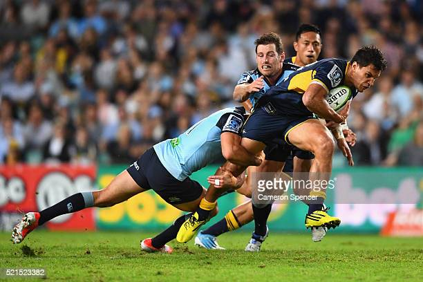 Matt Toomua of the Brumbies is tackled during the round eight Super Rugby match between the Waratahs and the Brumbies at Allianz Stadium on April 16...
