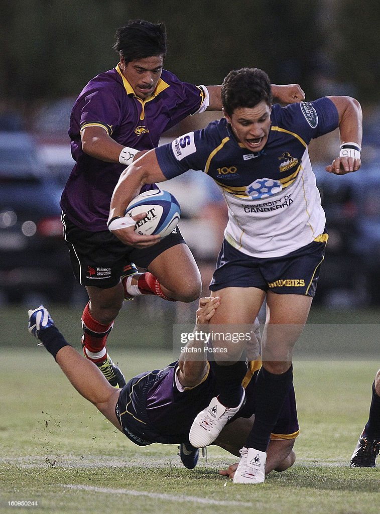 Matt Toomua of the Brumbies is tackled during the Super Rugby trial match between the Brumbies and the ACT XV at Viking Park on February 8, 2013 in Canberra, Australia.