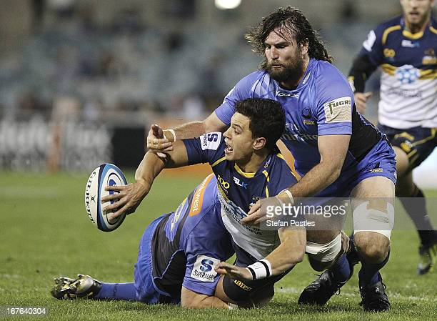 Matt Toomua of the Brumbies off loads the ball during the round 11 Super Rugby match between the Brumbies and the Force at Canberra Stadium on April...