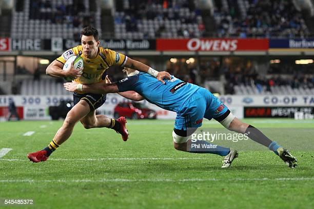 Matt Toomua of the Brumbies ruins in to score a try during the round 16 Super Rugby match between the Blues and the Brumbies at Eden Park on July 8...