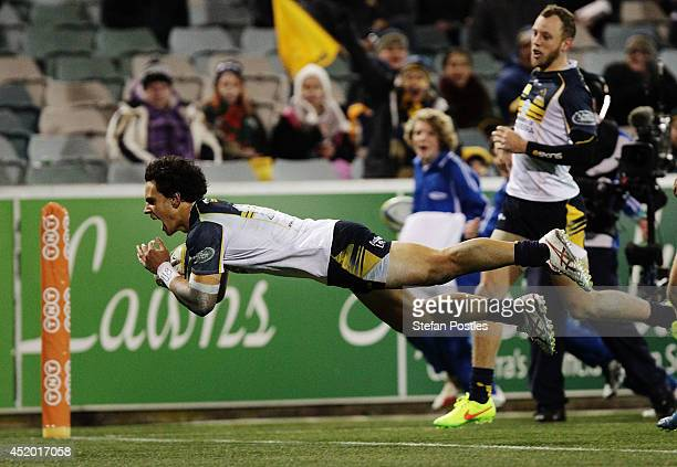 Matt Toomua of the Brumbies scores a try during the round 19 Super Rugby match between the Brumbies and the Force at Canberra Stadium on July 11 2014...