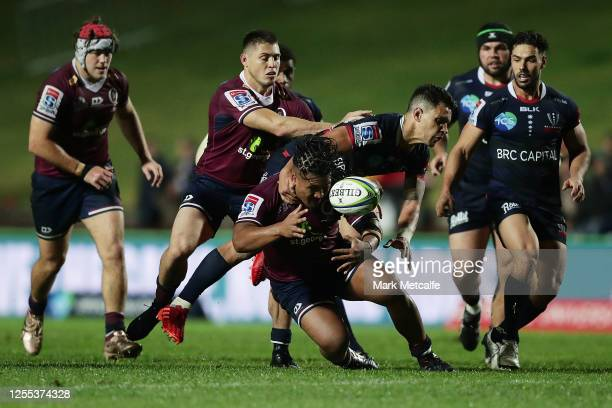 Matt Toomua of the Rebels and Brandon Paenga-Amosa of the Reds compete for the ball during the round 2 Super Rugby AU match between the Rebels and...