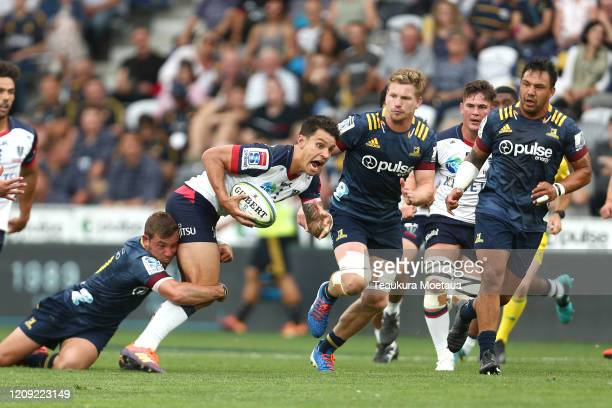 Matt Toomua of the Rebels looks to pass during the round five Super Rugby match between the Highlanders and the Rebels at Forsyth Barr Stadium on...