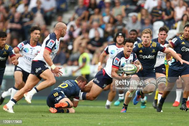 Matt Toomua of the Rebels passes during the round five Super Rugby match between the Highlanders and the Rebels at Forsyth Barr Stadium on February...
