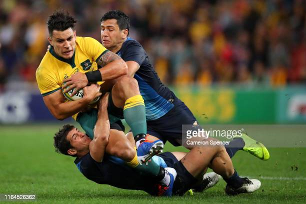 Matt To'omua of the Wallabies is tackled during the 2019 Rugby Championship Test Match between Australia and Argentina at Suncorp Stadium on July 27...
