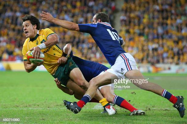 Matt Toomua of the Wallabies offloads whilst being tackled during the First International Test Match between the Australian Wallabies and France at...