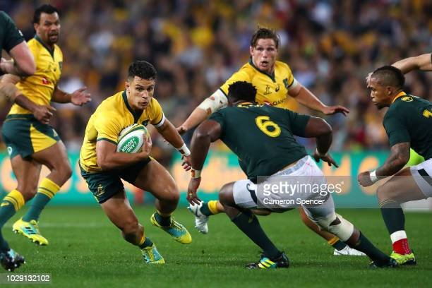 Matt Toomua of the Wallabies runs the ball during The Rugby Championship match between the Australian Wallabies and the South Africa Springboks at...