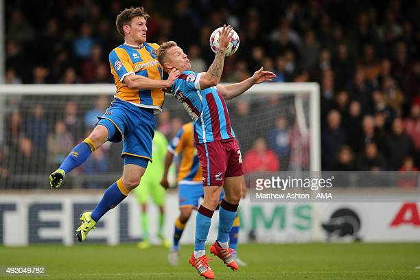 Matt Tootle of Shrewsbury Town and Gary McSheffrey of Scunthrope United during the Sky Bet League One match between Scunthorpe United and Shrewsbury...
