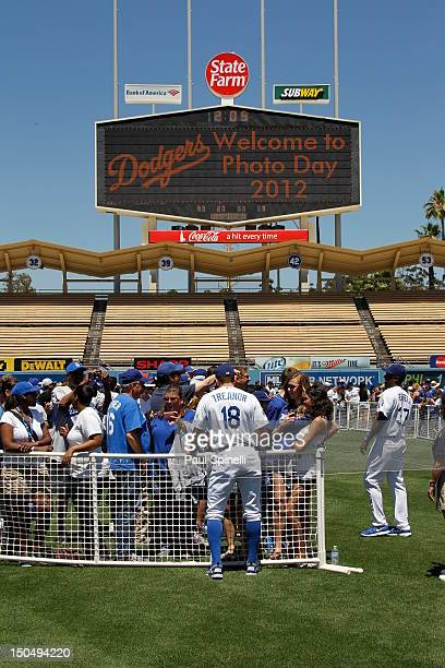 Matt Treanor and Elian Herrera of the Dodgers meet and take photos with fans at fan photo day before the game against the New York Mets on Saturday...