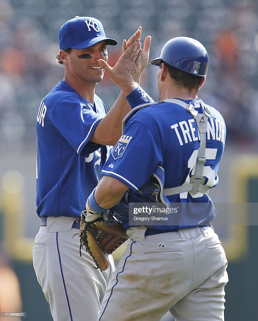 Matt Treanor #15 of the Kansas City Royals celebrates beating the Detroit Tigers 9-5 with Jeff Francoeur #21 at Comerica Park on April 10, 2011 in Detroit, Michigan.