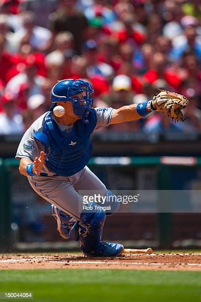 Matt Treanor of the Los Angeles Dodgers attempts to reach an errant throw during the game against the Philadelphia Phillies at Citizens Bank Park on...