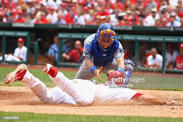 Matt Treanor of the Los Angeles Dodgers tags out Matt Carpenter of the St Louis Cardinals at home plate at Busch Stadium on July 26 2012 in St Louis...