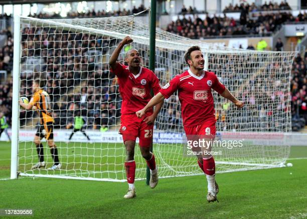 Matt Tubbs of Crawley Town celebrates with teammate Tyrone Barnett after scoring during the FA Cup with Budweiser Fourth Round match between Hull...