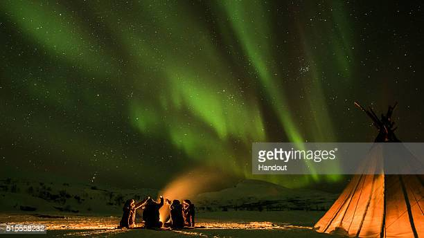 Matt Tuck and his friends toast to success beneath the northern lights after Jagermeister's Ice Cold Gig became the world's first air sea and land...