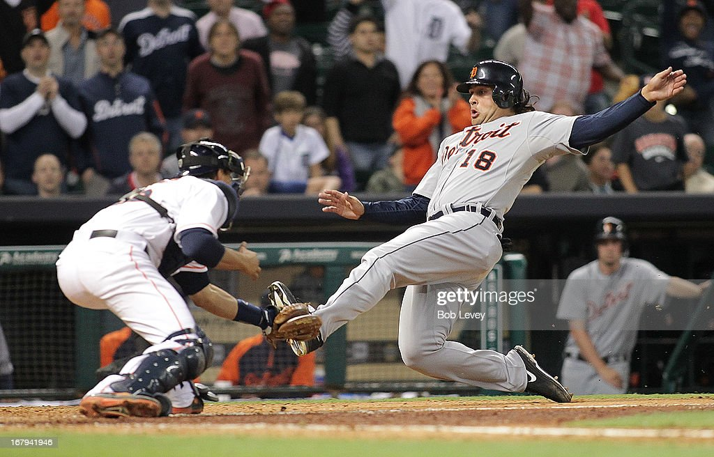 Matt Tuiasosopo #18 of the Detroit Tigers is tagged out by Jason Castro #15 of the Houston Astros in the 11th inning trying to score on a single by Rhiner Cruz (not pictured) of the Astros at Minute Maid Park on May 2, 2013 in Houston, Texas.