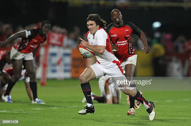 Matt Turner of England races away to score a try against Kenya during the IRB Sevens tournament at the Dubai Sevens Stadium on December 4 2009 in...