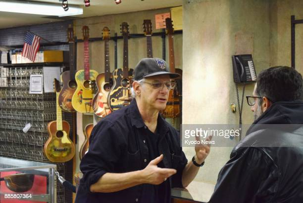 Matt Umanov head of a legendary guitar shop bearing his name in New York speaks to a customer in New York on Dec 3 the shop's last day of business...
