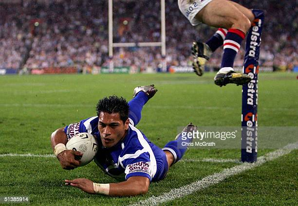 Matt Utai of the Bulldogs dives over for a try during the NRL Grand Final between the Sydney Roosters and the Bulldogs held at Telstra Stadium...