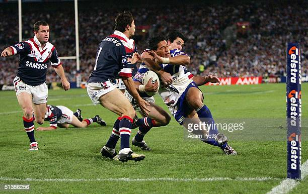 Matt Utai of the Bulldogs goes over for a try during the NRL Grand Final between the Sydney Roosters and the Bulldogs held at Telstra Stadium October...