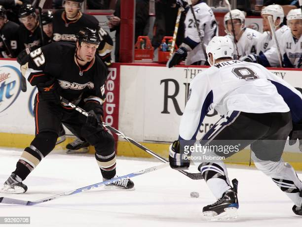 Matt Walker of the Tampa Bay Lighting defends against Kyle Calder of the Anaheim Ducks during the game on November 19 2009 at Honda Center in Anaheim...