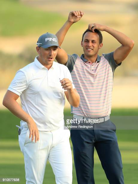 Matt Wallace and Chris Hanson of England speak on the 16th hole during round two of the Omega Dubai Desert Classic at Emirates Golf Club on January...